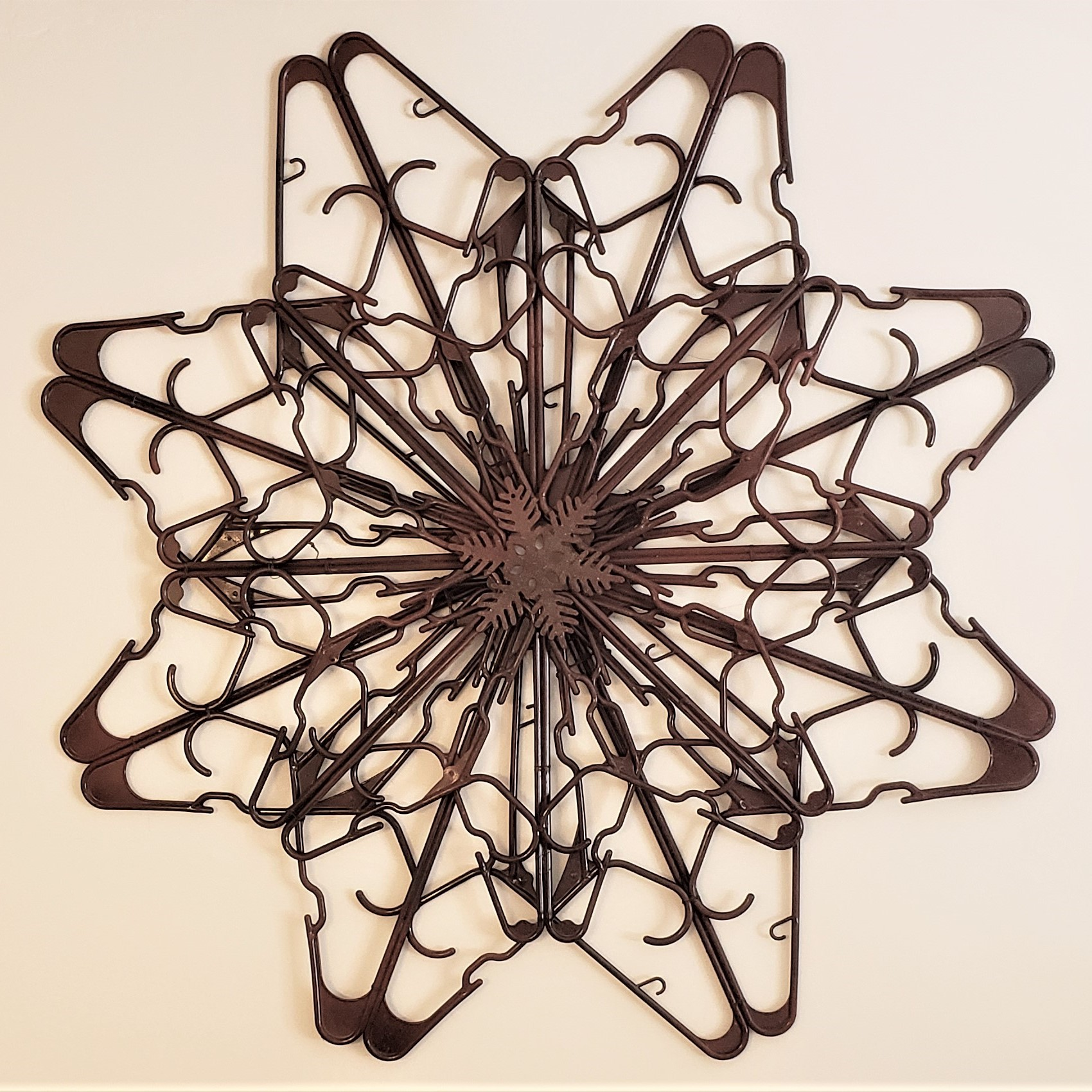 Faux Rusty Metal Snowflake from Dollar Tree Plastic Hangers